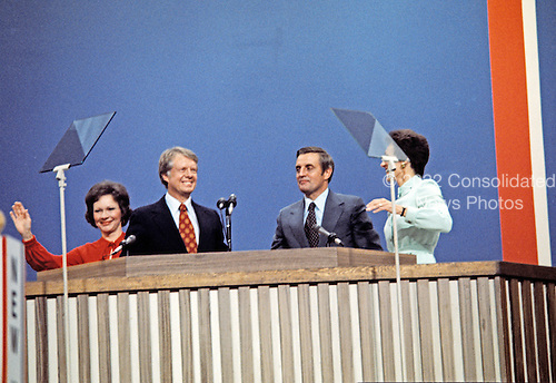 Governor Jimmy Carter (Democrat of Georgia), the 1976 Democratic Party nominee for President of the United States, left, and US Senator Walter Mondale (Democrat of Minnesota), the 1976 Democratic Party nominee for Vice President of the US, right, acknowledge the cheers of the delegates following their acceptance speeches at the 1976 Democratic Convention  at Madison Square Garden, New York, New York on July 15, 1976.<br /> Credit: Arnie Sachs / CNP