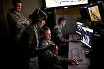 From left, Lt. Colonel Jason Brown, First Lieutenant Jamie Christopher, Tech Sergeant Jeremy Bennett, and Airman Joshua Wolff work on the operations floor at Beale Air Force Base in Linda, Calif., April 30, 2010.