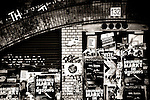 An old nostalgic and scribbled billboard with graffiti under a brick bridge on May 10, 2016 in Berlin.