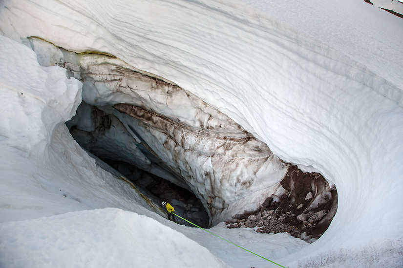 Exploring the Cerberus Moulin on Mt Hood which connects to Pure Imagination cave. A moulin is a vertical shaft in a glacier caused by melt water.