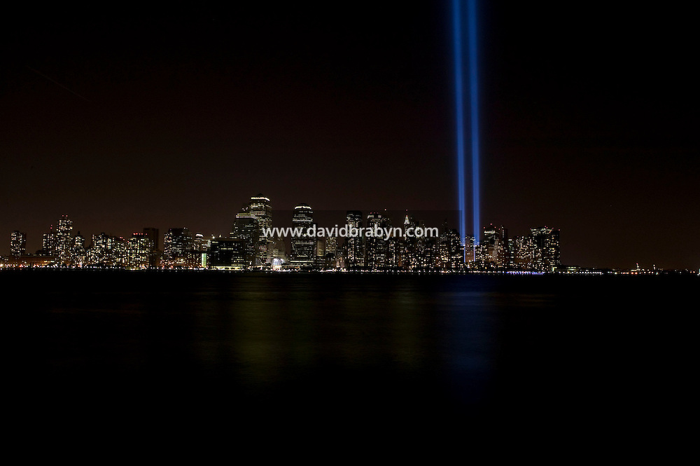 11 September 2005 - New York City, NY - A one-night installation shines beams of light up into the sky above Downtown Manhattan in New York City, USA, on 11 September 2005, the fourth annniversary of 9/11, as a tribute to victims of the terrorist attacks. Photo Credit: David Brabyn.