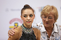 "(L-R) Evgenia Kanaeva of Russia (with her coach Vera Shtelbaums) smiles at ""kiss & cry"" after her hoop routine and on way to winning All-Around gold at 2008 European Championships at Torino, Italy on June 6, 2008.  Photo by Tom Theobald."