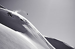 a snowboarder flies through the clear spring sky near Whistler, BC, Canada.