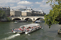 General view of Paris including the River Seine with the Pont Royal and the Musée d'Orsay in the background. Also a pleasure boat. Ref: 200306061982..Copyright Image from Victor Patterson, 54 Dorchester Park, Belfast, UK, BT9 6RJ..Tel: +44 28 9066 1296.Mob: +44 7802 353836.Voicemail +44 20 8816 7153.Skype: victorpattersonbelfast.Email: victorpatterson@mac.com.Email: victorpatterson@ireland.com (back-up)..IMPORTANT: If you wish to use this image or any other of my images please go to www.victorpatterson.com and click on the Terms & Conditions. Then contact me by email or phone with the reference number(s) of the image(s) concerned.
