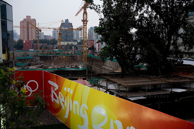 """Walls cover construction projects and """"ugly"""" areas for the Olympics in Beijing, China on Monday, August 18, 2008.  Kevin German"""