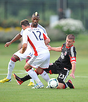 Perry Kitchen (23) of D.C. United goes against Andy Dorman (12) of the New England Revolution. D.C. United defeated the The New England Revolution 3-1 in the Quarterfinals of Lamar Hunt U.S. Open Cup, at the Maryland SoccerPlex, Tuesday June 26 , 2013.