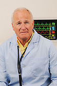 Senior medical Doctor Senior medical MD with vital monitor stock photo