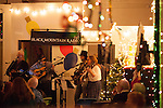Guests gather at 359 State Street for First Friday festivities, including music by Black Mountain Radio, Dec. 7.