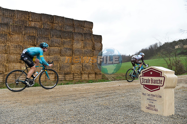 Riders pass by the newly dedicated stone to 3 time winner Fabian Cancellara (SUI) as they climb gravel sector 8 Monte Santa Maria during the 2017 Strade Bianche running 175km from Siena to Siena, Tuscany, Italy 4th March 2017.<br /> Picture: La Presse/Fabio Ferrari | Newsfile<br /> <br /> <br /> All photos usage must carry mandatory copyright credit (&copy; Newsfile | La Presse)