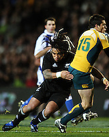 Ma'a Nonu tackles Adam Ashley-Cooper as he catches a high ball during the Tri Nations match between the NZ All Blacks and Australia at Eden Park, Auckland, New Zealand on Saturday 14 July 2009. Photo: Dave Lintott / lintottphoto.co.nz