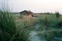 A deserted house on the bank of Ganges on the way to Hossenpur village, Murshidabad District, West Bengal, India.