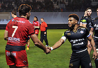Juan Fernandez Lobbe of Toulon and Kyle Eastmond of Bath Rugby shake hands after the match. European Rugby Champions Cup match, between RC Toulon and Bath Rugby on January 10, 2016 at the Stade Mayol in Toulon, France. Photo by: Patrick Khachfe / Onside Images