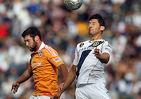 CARSON, CA - DECEMBER 01, 2012:   Omar Gonzalez (4) of the Los Angeles Galaxy heads away from Will Bruin (12) of the Houston Dynamo during the 2012 MLS Cup at the Home Depot Center, in Carson, California on December 01, 2012. The Galaxy won 3-1.
