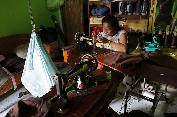 Seamstress working in her home shop, Makassar, Sulawesi, Indonesia.