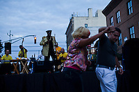 People dances while they attend the National Night Out festivities in Union City, New Jersey, Aug 6, 2013. Photo by Eduardo Munoz Alvarez / VIEWpress.