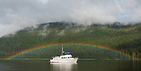 Rainbow arching over charter boat in Windfall Harbor on Admiralty Island National Monument in the Inside Passage of Southeast Alaska. Summer. Evening. PR_2008-2.