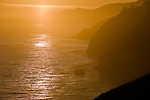 Sunset reflections on Pacific Ocean and coast, Big Sur, California