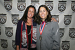 15 January 2009: 2009 National Soccer Hall of Fame player electee Joy Fawcett (left) with former teammate and Hall of Famer Julie Foudy (right). The election announcement press conference was held at the Convention Center in St. Louis, Missouri in conjuction with the National Soccer Coaches Association of America's annual convention.