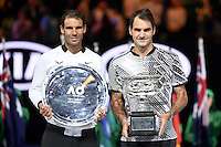 January 29, 2017: Roger Federer of Switzerland poses for photographs with Rafael Nadal of Spain after winning the Men's Final on day 14 of the 2017 Australian Open Grand Slam tennis tournament in Melbourne, Australia. Photo Sydney Low