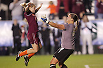07 November 2008: Virginia Tech's Kelly Lynch (left) leaps into the arms of Virginia Tech goalkeeper Kristin Carden after Carden's fourth save of the penalty kick shootout clinched advancement. The University of Virginia and Virginia Tech played to a 1-1 tie after 2 overtimes at WakeMed Stadium at WakeMed Soccer Park in Cary, NC in a women's ACC tournament semifinal game.  Virginia Tech advanced to the final on penalty kicks, 2-1.