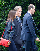 Deputy National Security Advisor for Strategy Dina Powell, left, Chief Strategist Steve Bannon, center, and Senior Advisor Stephen Miller, right, walk to the West Wing after disembarking from Marine One on the South Lawn of the White House in Washington, DC after traveling with United States President Donald J. Trump to Lynchburg, Virginia where the President made remarks at the Liberty University Commencement ceremony on Saturday, May 13, 2017.<br /> Credit: Ron Sachs / Pool via CNP /MediaPunch