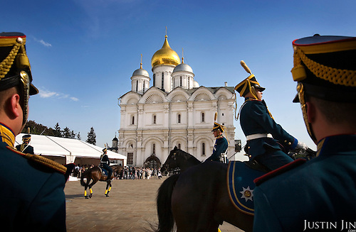 Horse-mount ceremonial guards give a show in Moscow's Kremlin to VIPs at a Cartier event.