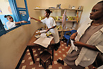 In a clinic of the United Methodist Church in Kananga, a town in the Democratic Republic of the Congo, nurse Agnes Ntumba (center) fills a prescription in the clinic's pharmacy.