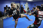 Florian Garel, Zendokai Karate Champion background with trainer, prepares for his fight in blue locker room<br />