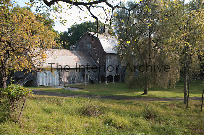 The property is embellished with an imposing unmodernised barn surrounded by trees