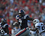 Ole Miss' Wayne Dorsey (7) intercepts a pass and is tackled by Southern Illinois' Steve Strother (28) at Vaught-Hemingway Stadium in Oxford, Miss. on Saturday, September 10, 2011.