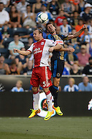 Michael Harrington (5) of the Portland Timbers goes up for a header with Sebastien Le Toux (11) of the Philadelphia Union during a Major League Soccer (MLS) match at PPL Park in Chester, PA, on July 20, 2013.