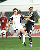 Juan Manuel Pena #3 of D.C. United loses the ball to Seth Sinovic #27 of the New England Revolution during an MLS match on April 3 2010, at RFK Stadium in Washington D.C.