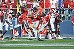 Ole Miss players celebrate a fumble recovery vs. Arkansas at Vaught-Hemingway Stadium in Oxford, Miss. on Saturday, October 22, 2011. .