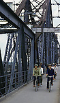 Heavily damaged during the Vietnamese war by American planes and repaired, the Paul Doumer Bridge's outer spans are now used only for foot and bicycle traffic in Hanoi, North Vietnam.  (Jim Bryant Photo)...