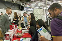 Workers from ADP speak to attendees at the TechDay New York event on Tuesday, April 18, 2017. Thousands attended to seek jobs with the startups and to network with their peers. TechDay bills itself as the U.S.'s largest startup event with over 500 exhibitors. (© Richard B. Levine)