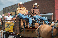 NWA Democrat-Gazette/ANTHONY REYES &bull; @NWATONYR<br /> Laurinda Joenks rides in the Corner Post Cowboy Church wagon Wednesday, July 1, 2015 during the Rodeo of the Ozarks' Parade on Emma Avenue in Springdale. This year's theme is &quot;A Patriotic American Classic.&quot;