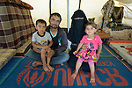 Mamon Al-Hariri and his wife Huda, along with their children Morad, 4, and Hiba, 3, inside their tent in the Zaatari refugee camp near Mafraq, Jordan. The family fled fighting in Daraa, Syria, in 2013, crossing the border into Jordan without appropriate paperwork. They'd like to move elsewhere, but aren't permitted to leave the camp. <br /> <br /> &quot;There's a big difference between life here and how we lived back home,&quot; said the woman. &quot;We're happy with our neighbors here, but I spend my whole life sitting in a tent when back home I had a beautiful house and garden.&quot;<br /> <br /> Established in 2012 as Syrian refugees poured across the border, the Zaatari camp held more than 80,000 refugees by 2015, and was rapidly evolving into a permanent settlement. ACT Alliance member agencies provide a variety of services to refugees living in the camp.