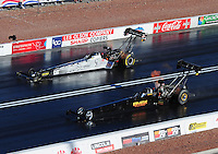 Apr. 1, 2011; Las Vegas, NV, USA: NHRA top fuel dragster driver Bob Vandergriff Jr (top) races alongside Troy Buff during qualifying for the Summitracing.com Nationals at The Strip in Las Vegas. Mandatory Credit: Mark J. Rebilas-