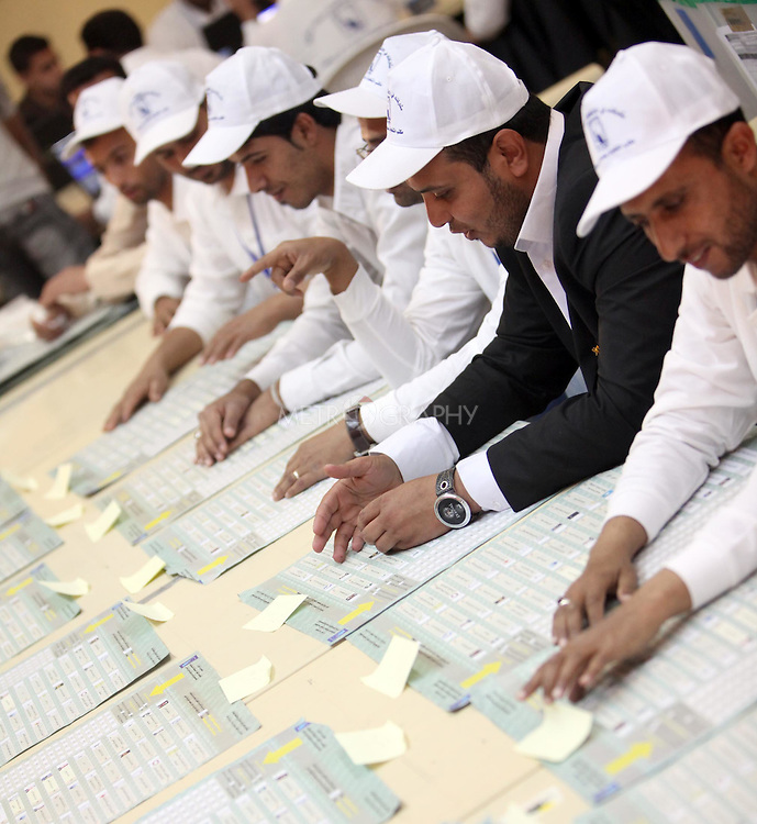 BAGHDAD, IRAQ:  Workers for the Independent High Electoral Commission (IHEC) count votes in Baghdad...On March 7th, 2010, Iraq held nationwide parliamentary elections...Photo by Ceerwan Aziz/Metrography