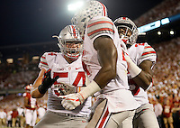 Ohio State Buckeyes offensive lineman Billy Price (54) and running back Mike Weber (25) celebrate after running back Curtis Samuel (4) runs for a 36-yard touchdown during the first quarter of the NCAA football game at Memorial Stadium in Norman, Oklahoma on Sept. 17, 2016. (Adam Cairns / The Columbus Dispatch)