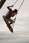 A surfer works out on the  surf swing on Praia do Rosa beach near Vida Sol e Mar Eco Resort, Santa Catarina, Brazil