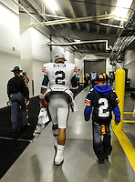 Photo by Gary Cosby Jr.   Cam Newton walks to the locker room with his little brother, Kaylin, following Auburn's 56-17 win in the Southeastern Conference Championship Game Saturday in Atlanta December 4, 2010.