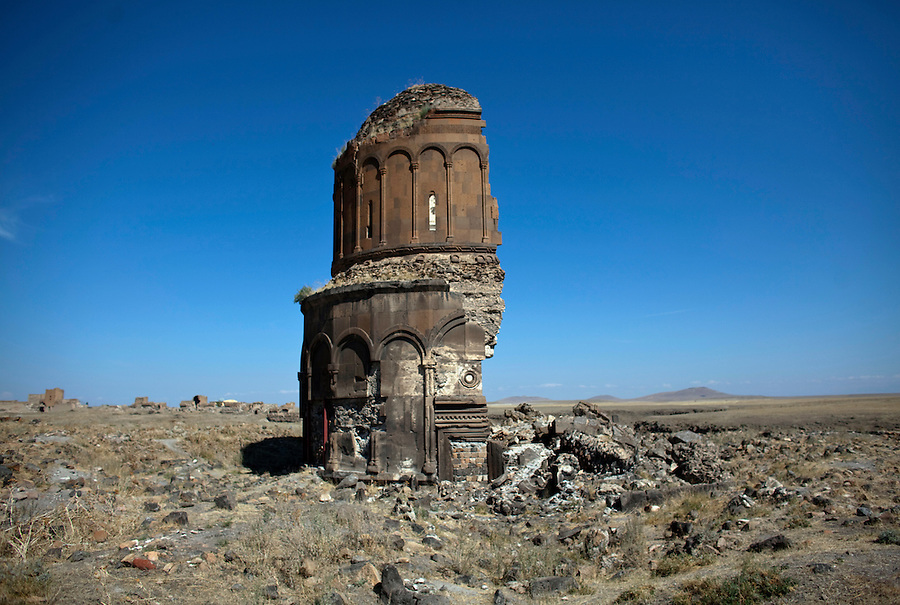 Ruins of Ani, in eastern Anatolia. Ani is a ruined and uninhabited medieval city-site situated in the Turkish province of Kars, beside the border with Armenia. It was once the capital of a medieval Armenian kingdom that covered much of present day Armenia and eastern Turkey. At its height, Ani had a population of 100,000 - 200,000 people and was the rival of Constantinople, Baghdad and Cairo. The Church of the Redeemer (Christ).