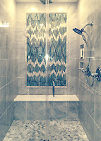 This custom shower features Loom, a handmade mosaic shown in Quartz, Aquamarine, Tanzanite and Turquoise jewel glass and part of the Ikat Collection by Sara Baldwin for New Ravenna Mosaics.<br />