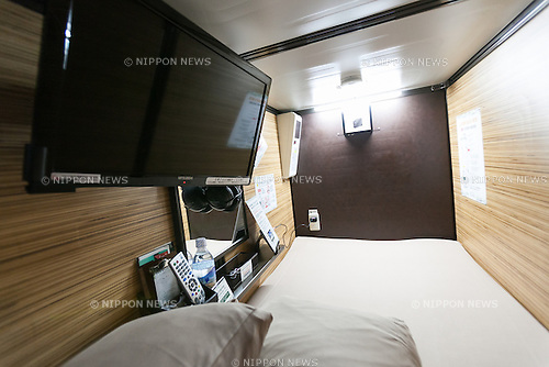 Anshin Oyado luxury capsule hotel located within 3-minutes of the busy Shinjuku station on August 7, 2016, Tokyo, Japan. The new take on the traditional Japanese capsule hotel offers larger capsules, free artificial hot springs & mist sauna, internet cafe and Wi-Fi. This hotel is male only and rates start at 5480 yen (54USD). Each of the hotel's 256 capsules is equipped with fire alarm, air conditioner, tablet computer and flat-screen TV. Public areas such as the hot springs bath, laundromat, clothing shop and snack and drinks vending machines are open 24 hours. The hotel's website is in Chinese, English, Korean and Japanese and welcomes male foreign travellers as well as Japanese businessmen who have missed their last train home. (Photo by Rodrigo Reyes Marin/AFLO)