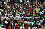 Palestinian youths gather at al-Najah University during a rally marking Land Day in in the West Bank city of Nablus on March 31, 2013. The annual demonstrations mark the deaths of six Arab Israeli protesters at the hands of Israeli police and troops during mass protests in 1976 against plans to confiscate Arab land in the northern Galilee region. Photo by Nedal Eshtayah
