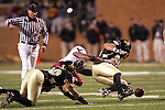 4 November 2006: Wake Forest's Jyles Tucker (right) recovers a fourth quarter Boston College fumble by L.V. Whitworth  (30). Wake Forest defeated Boston College 21-14 at Groves Stadium in Winston-Salem, North Carolina in an Atlantic Coast Conference college football game.