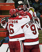 Alex Fallstrom (Harvard - 16), Danny Biega (Harvard - 9) and Everson celebrate Everson's goal which made it 3-1 just 12 seconds into the third period. - The Harvard University Crimson defeated the St. Lawrence University Saints 4-3 on senior night Saturday, February 26, 2011, at Bright Hockey Center in Cambridge, Massachusetts.