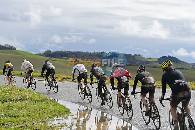 A wet day for the 5000 riders on the roads of Tuscany the 2017 Strade Bianche Gran Fondo running 127km from Siena to Siena, Tuscany, Italy 5th March 2017.<br /> Picture: La Presse/Fabio Ferrari | Newsfile<br /> <br /> <br /> All photos usage must carry mandatory copyright credit (&copy; Newsfile | La Presse)