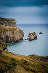 Sea-carved sandstone cliffs, rock arches and caves at Tunnel Beach, Dunedin, New Zealand